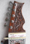headstock with gear tuners on sitar